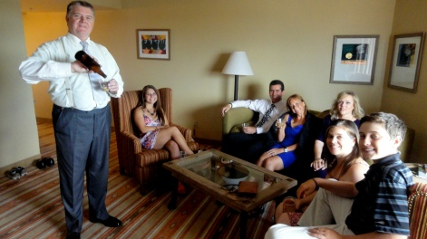 My big brother serving home brew to my cousins during my niece's wedding weekend