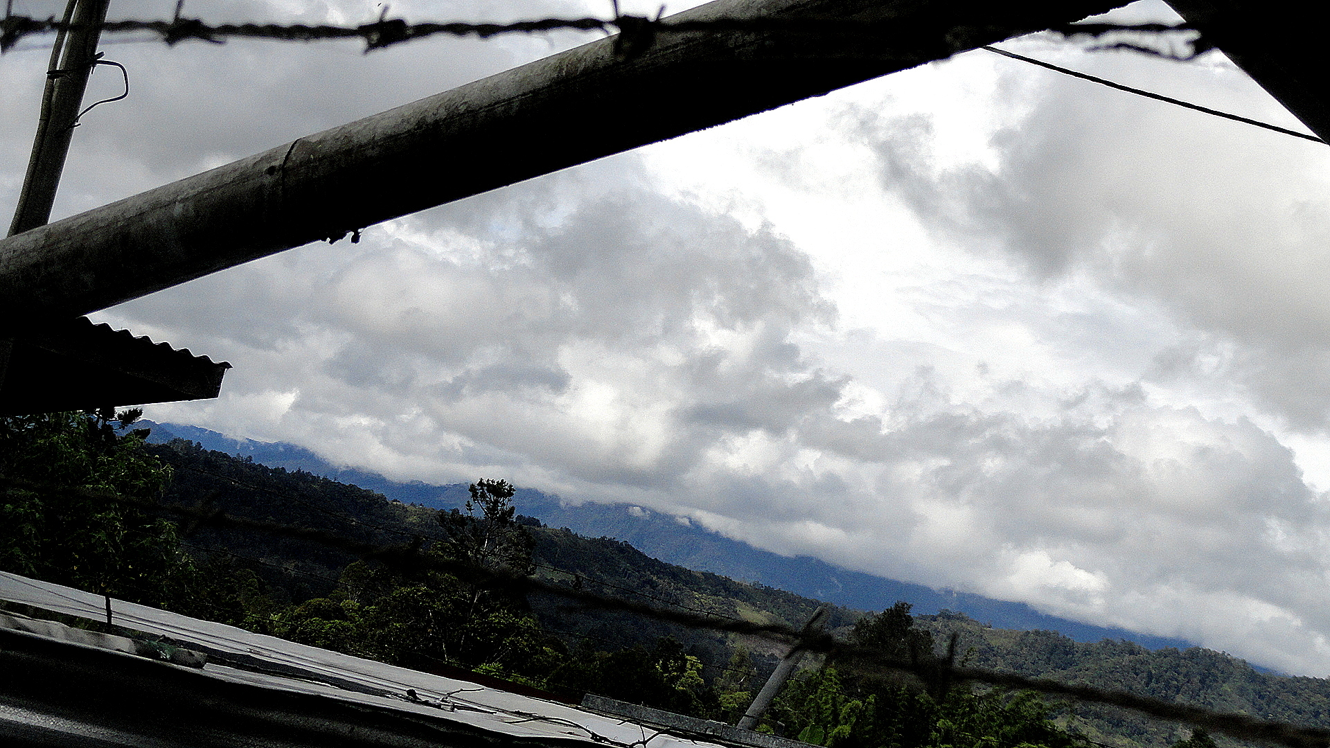 Water Tanks - Barbed Wire - Mountains