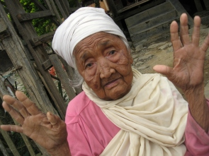 Woman in Sajik Tampak